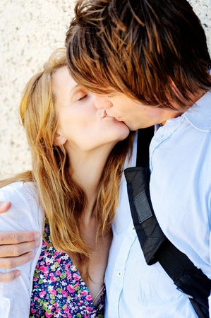 closeup of a vibrant couple kissing each other with passion photo