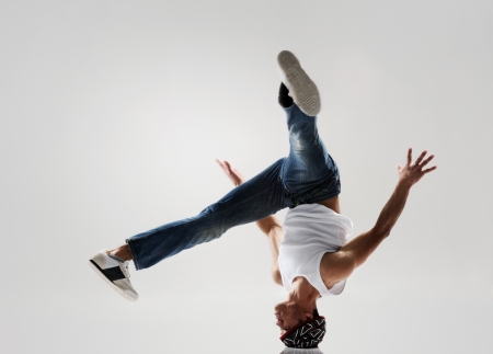 headstand: breakdancer frozen in mid head spin, classic modern hip hop or break dance move Stock Photo