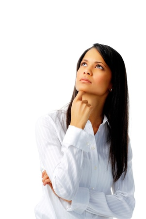 Indian businesswoman touching her chin and looking up, isolated on white