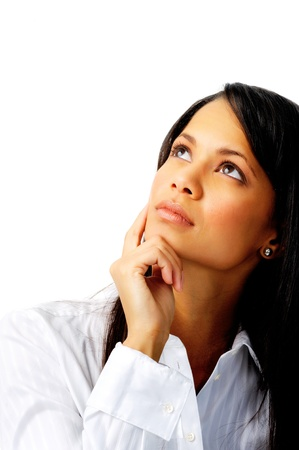 Thoughtful businesswoman touching her chin and looking up, isolated on white photo