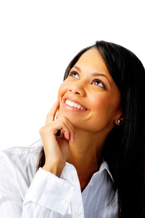 Smiling businesswoman looking up photo