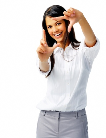 confianza: Feliz mujer utiliza los dedos como una frontera, aislado en blanco Foto de archivo