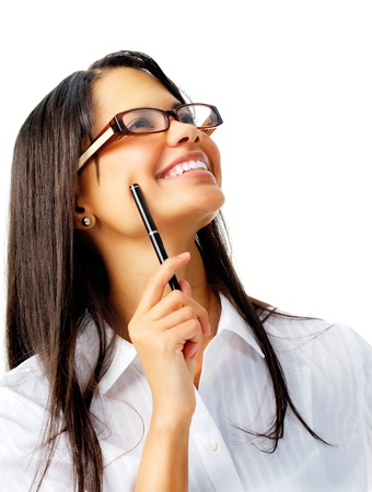 Happy latino woman holding a pen and looking up with glasses, isolated on white photo