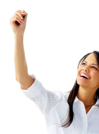 Laughing woman in white blouse stretches her arm to write, isolated on white photo