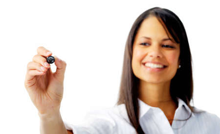 Smiling businesswoman writes with a felt tip pen, isolated on white photo