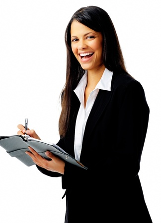 young businesswoman laughing while writing in her organizer, isolated on white photo