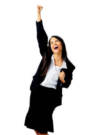 Successful businesswoman celebrates with her arms up in victory, isolated on white photo