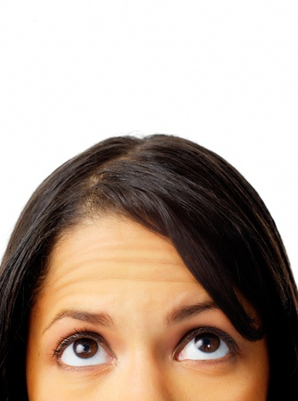 Close-up of a womans face looking upward in an idea pondering pose
