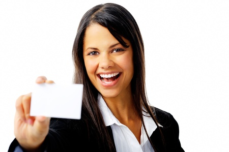 businesswoman card: joyful young businesswoman holding a businesscard and laughing isolated on white