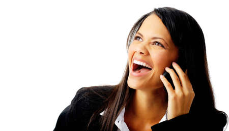 portrait of a mixed race businesswoman laughing while talking on the phone photo