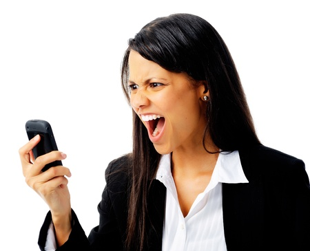 woman has an angry emotion reaction while screaming at her cell phone photo