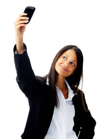 cute businesswoman taking a self portrait with her cell phone Stock Photo - 12347455