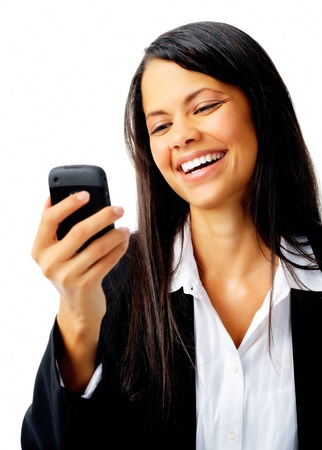 woman laughing with cell phone text message while wearing a suit isolated on white photo