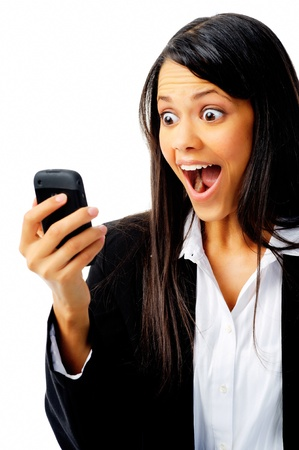adult indian: woman has a reaction of surprise as she reads a message on her mobile phone, isolated on white.