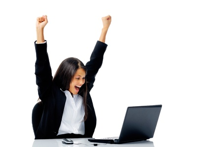 woman with laptop arms raised in victorious celebration of success, isolated on white photo