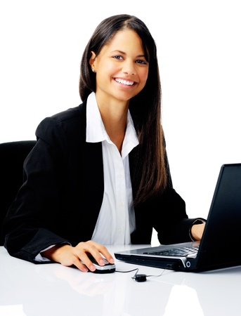 cheerful young businesswoman working at her computer isolated on white photo