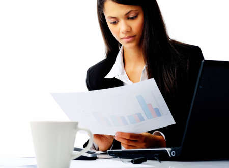 businesswoman entrereneur  reading sales statistics while sitting at her desk isolated on white Stock Photo - 12334184