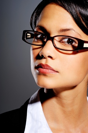 geeky: Asian woman in business suit with spectacles