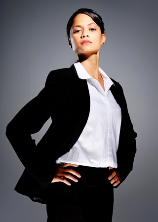 Successful businesswoman in suit with her hands on her hips photo