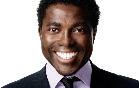 black african businessman portrait headshot smiling and positive photo