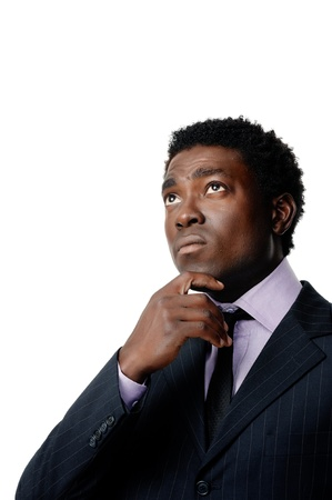 Black african businessman thinking and looking upward isolated on white photo
