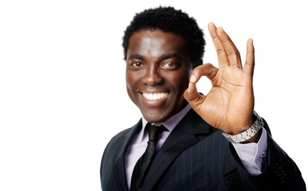 african businessman: ok hand sign gesture from a black african businessman