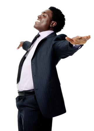 carefree black businessman stands with his arms out in a relaxed pose isolated on white photo