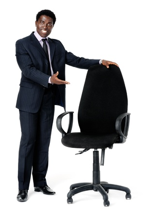 executive chair: welcoming black businessman recruitment concept with and empty office chair. Isolated on white Stock Photo