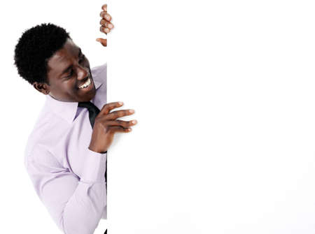 Black african businessman standing with a blank empty board providing copyspace for any advertising material. Stock Photo - 12752849