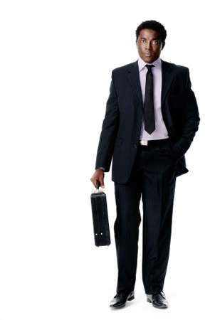 business briefcase: Black african businessman stnding holding a briefcase isolated on white Stock Photo