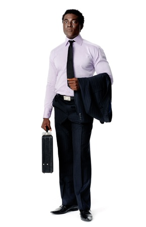 Black african businessman stnding holding a briefcase isolated on white photo