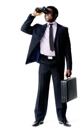 Businessman searches for a new company vision with his binoculars and briefcase photo