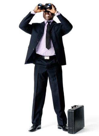 looking at watch: Businessman searches for a new company vision with his binoculars and briefcase Stock Photo