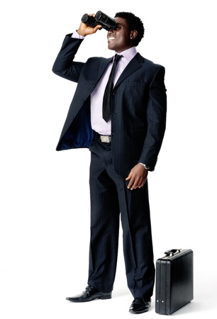 binoculars view: Businessman searches for a new company vision with his binoculars and briefcase Stock Photo