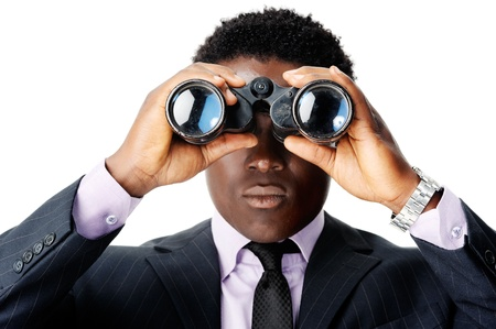 looking towards camera: serious binocular businessman looking towards camera. african man Stock Photo