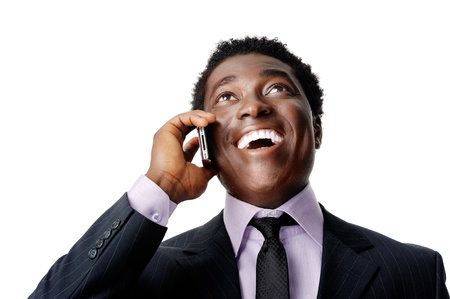Happy business conversation african man laughing and chatting on the phone Stock Photo - 12753321