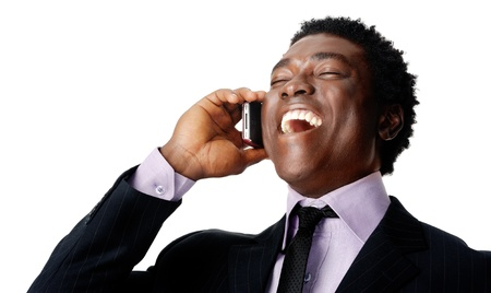 man with phone: Happy business conversation african man laughing and chatting on the phone Stock Photo