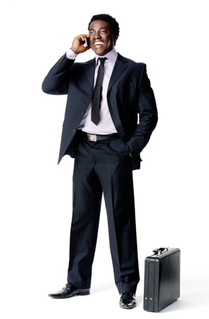 standing businessman on the phone with briefcase isolated on white Stock Photo - 12753080