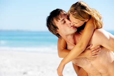 romantic sexy couple: kissing summer beach couple on vacation in a tropical island scene