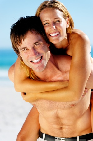 sexy couple embrace: carefree couple embrace and enjoy some summer beach loving on a tropical island Stock Photo