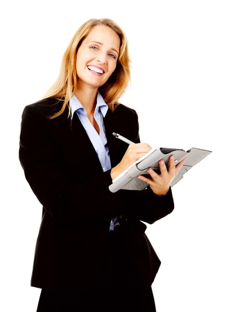 succesful: Businesswoman writing in her organizer diary while smiling and happy Stock Photo