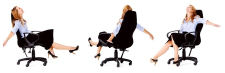 arms on chair: carefree business woman spinning on her office chair having fun, laughing and smiling happy and free. Stock Photo
