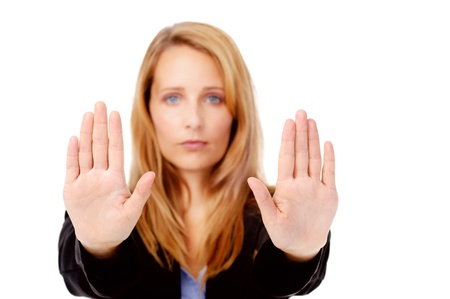 resist: stop hand gesture with business woman, selective focus