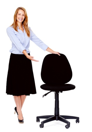 recruitment concept business woman standing with empty office chair isolated on white photo