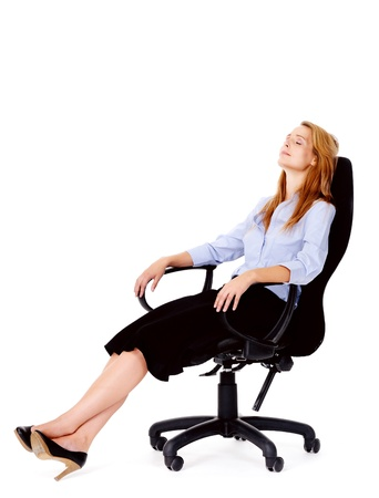 ofis koltuğu: Business woman sitting in office chair relaxing isolated on white Stok Fotoğraf