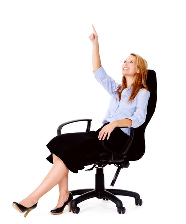 Business woman sitting in office chair relaxing isolated on white Stock Photo - 13025432