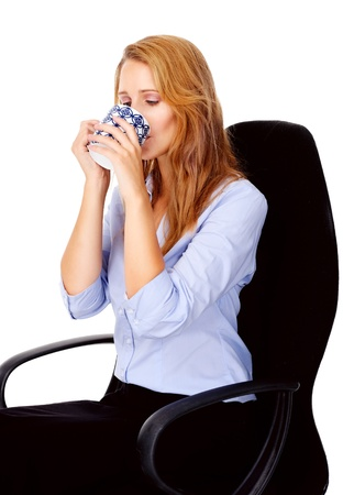 businesswoman drinking from coffee cup Stock Photo - 13025683