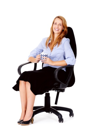 succesful: Business woman sitting in office chair relaxing with a cup of coffee isolated on white