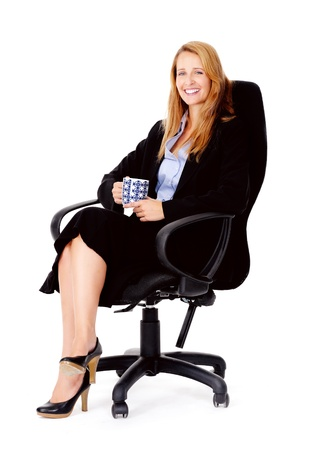 Business woman sitting in office chair relaxing with a cup of coffee isolated on white Stock Photo - 13025519