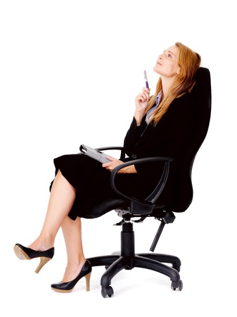 thoughtful businesswoman sitting in office chair has an idea Stock Photo - 13025481